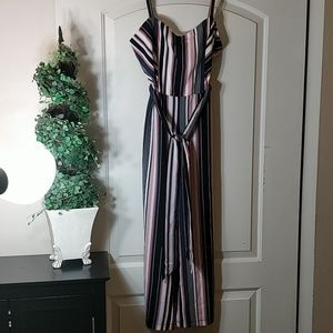 Bebe stripped jumpsuit size 8 nwt
